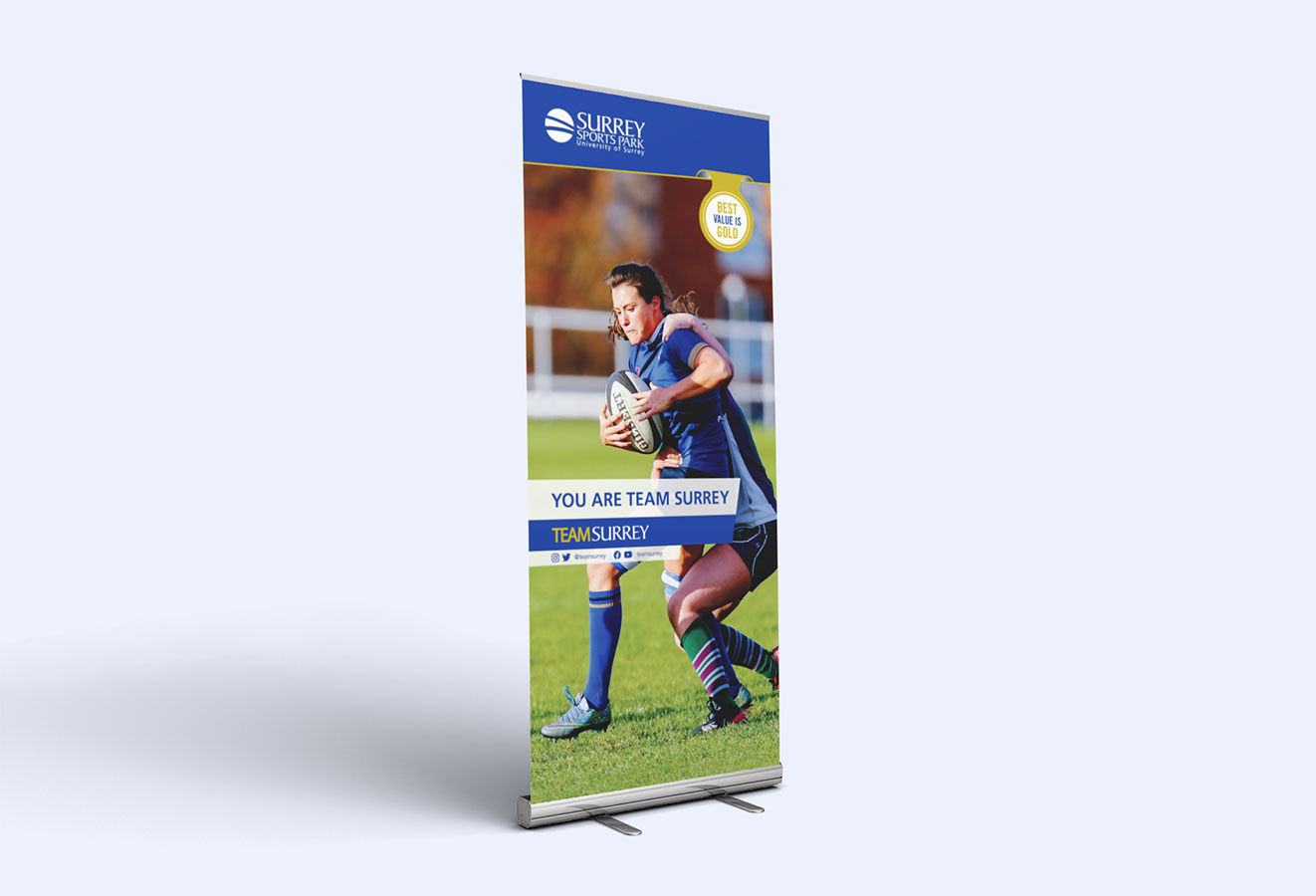 Team Surrey pull up banner with players from women's rugby team