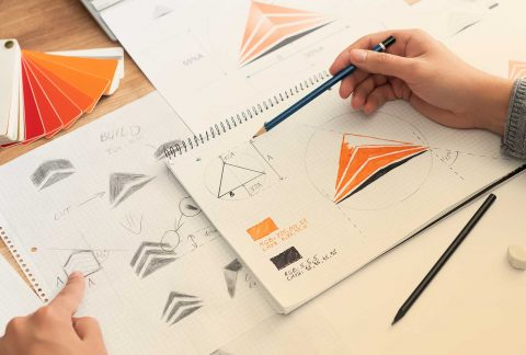 Graphic designer planning which types of logo are best